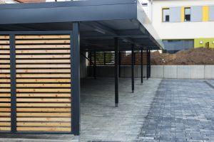 modern flat steel carport installation in Sydney